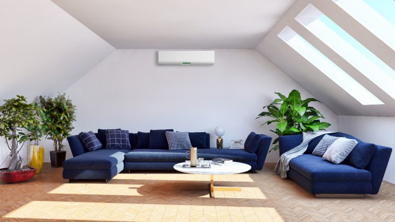 Wall mounted air conditioning unit in loft conversion room