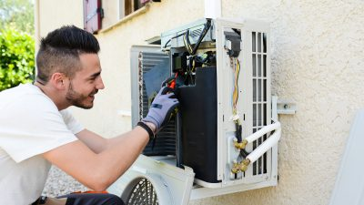 Air conditioning engineer performs an air conditioning service