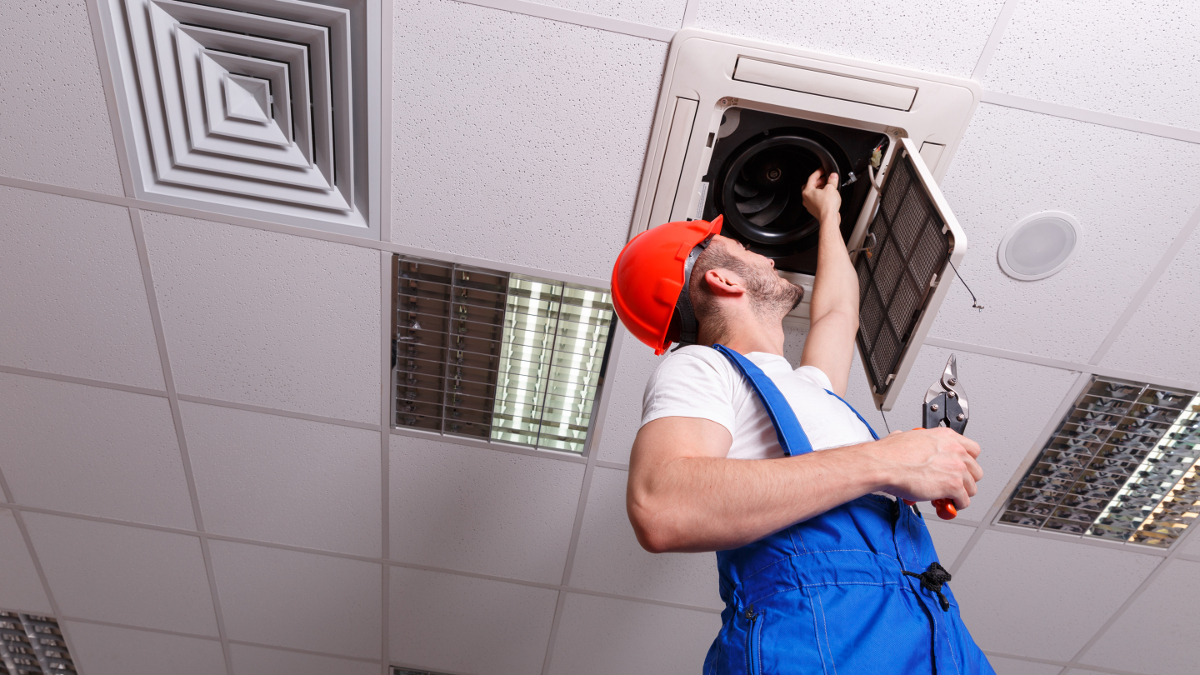 Air conditioning engineer services a ceiling cassette unit