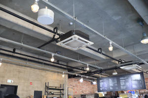 Ceiling cassette air conditioning unit in large industrial room