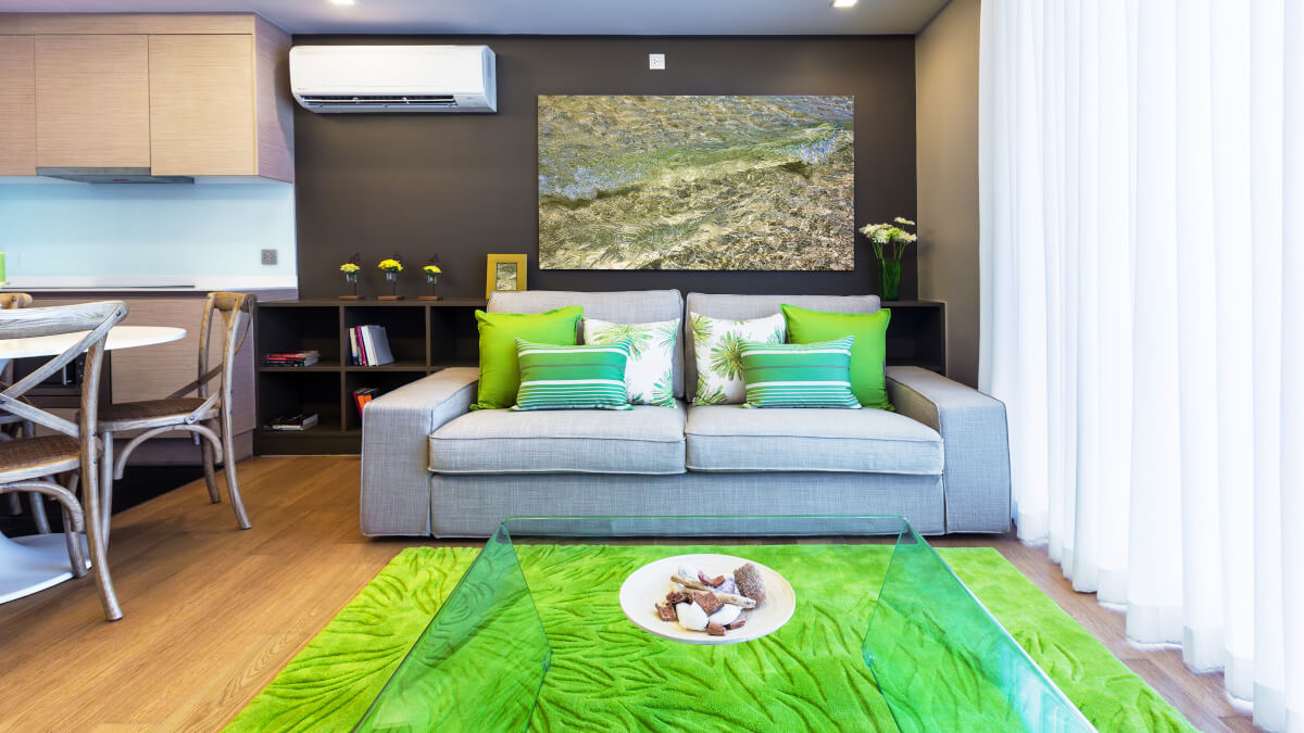 heating and air conditioning in open plan area with green soft furnishings